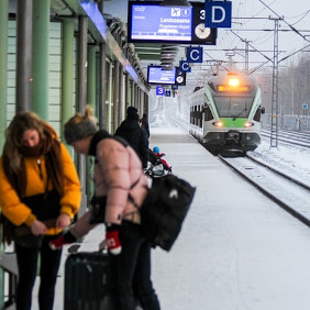People waiting for a train in winter